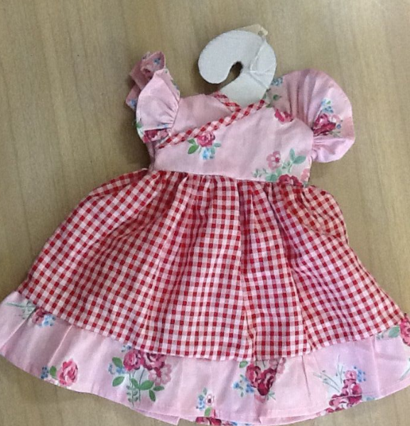 Pretty floral and check dress and bloomers with cross over detail, to fit approx fourteen inch doll.